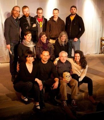 "Cast & Crew of ""Ghosts in Baghdad"" Top Row, L-R: John Murphy (Director); Jordan Watkins (Sound); Corwin Ferguson (Projection); Darren Boquist (Lighting); Sebastian Kroon (Production). Middle Row: Rebecca Mulvihill (SM), Michelle Deines (Playwright); Beth Snelgrove (Set and Props). Front Row: Sarah May Redmond (Malika); Joshua Drebit (Hamza); Alec Willows (Khalil); Gili Roskies (Noor). Photo by Tim Matheson."