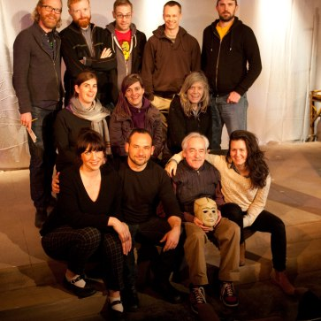 "Cast & Crew of ""Ghosts in Baghdad"" Top Row, L-R: John Murphy (Director); Jordan Watkins (Sound); Corwin Ferguson (Projection); Darren Boquist (Lighting); Sebastian Kroon (Production). Middle Row: Rebecca Mulvihill (SM), Michelle Deines (Playwright); Beth Snelgrove (Set and Props). Front Row: Sarah May Redmond (Malika); Joshua Drebit (Hamza); Alec Willows (Khalil); Gili Roskies (Noor). Photo by Tim Matheson."