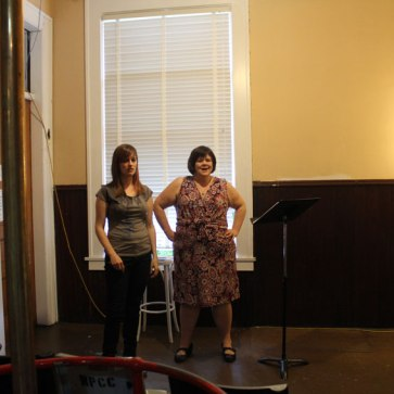 "Reading of ""I am the Bastard Daughter of Engelbert Humperdinck"" at the Firehall Arts Centre, 2013. Michelle Deines and Kathryn KIrkpatrick. Photo by Nancy Kirkpatrick."