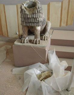 Terra cotta statue of lion from around 1800 BC damaged by looters in 2003.