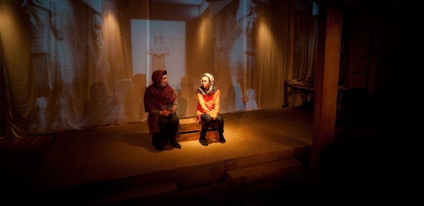 "Another example from ""Ghosts in Baghdad,"" in which you can see projection interacting with the live action of the play. Sarah May Redmond (Malika) and Gili Roskies (Noor); Amy McDougall, Costumes; C. Ferguson, Projection; B. Snelgrove, Sets; Darren Boquist, Lighting. Photo by Tim Matheson."