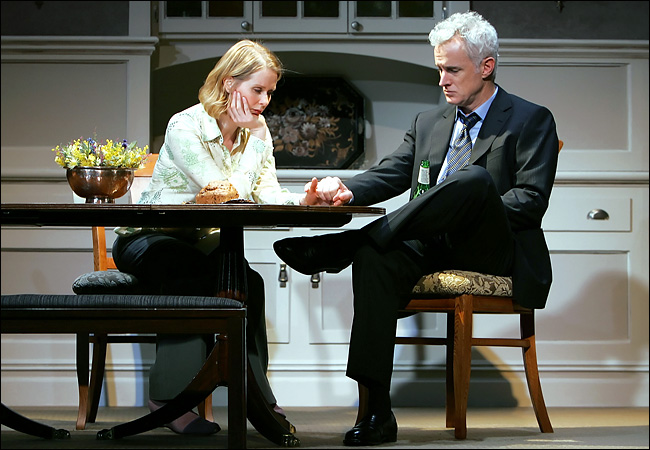 "The considered spectacle of Manhattan Theatre Club's production of ""The Rabbit Hole."" Cynthia Nixon and John Slattery, actors pictured; John Lee Beatty, Sets; Jennifer von Mayrhauser, Costumes; Christopher Akerland, Lighting; Daniel Sullivan, Director. Photo by Sara Krulwich."